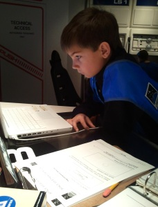 Jordan Theriault of Caribou Middle School conducted experiments in Challenger's simulated space lab.