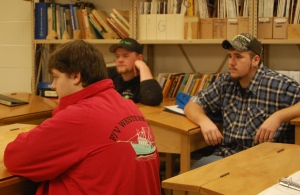 Students Lucas Eaton (black cap), Devon (green cap) and Dan Fill  speak with Commissioner Bowen.