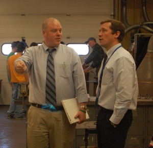 DISHS principal Todd West shows Commissioner Bowen a technical trades area of the school.