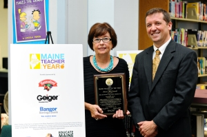 2014 Maine Teacher of the Year Karen MacDonald, of King Middle School in Portland, and Education Commissioner Stephen Bowen