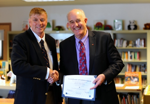 Maine Education Commissioner Jim Rier presents Rose M. Gaffney School Principal Mitchell Look with a certificate of achievement for earning an A on their 2014 school report card. The school received a C last year.