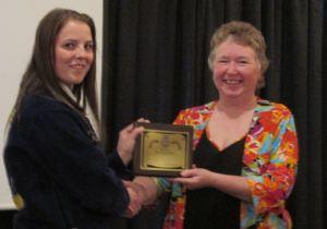Maine FFA State President Whitnie Bradbury bestows Honorary State Degree upon Maine DOE employee Elaine Briggs