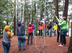Maine FFA students working together at ropes course with students from other states.