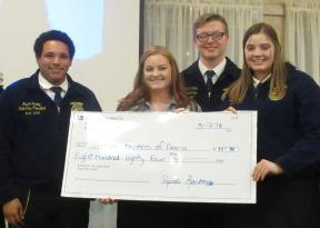 Ms. Randi Rackleff of the Somerset Auction Company presents a $884 check for the auction proceeds of the 2016 Agricultural Trades Show to the Maine FFA Association.
